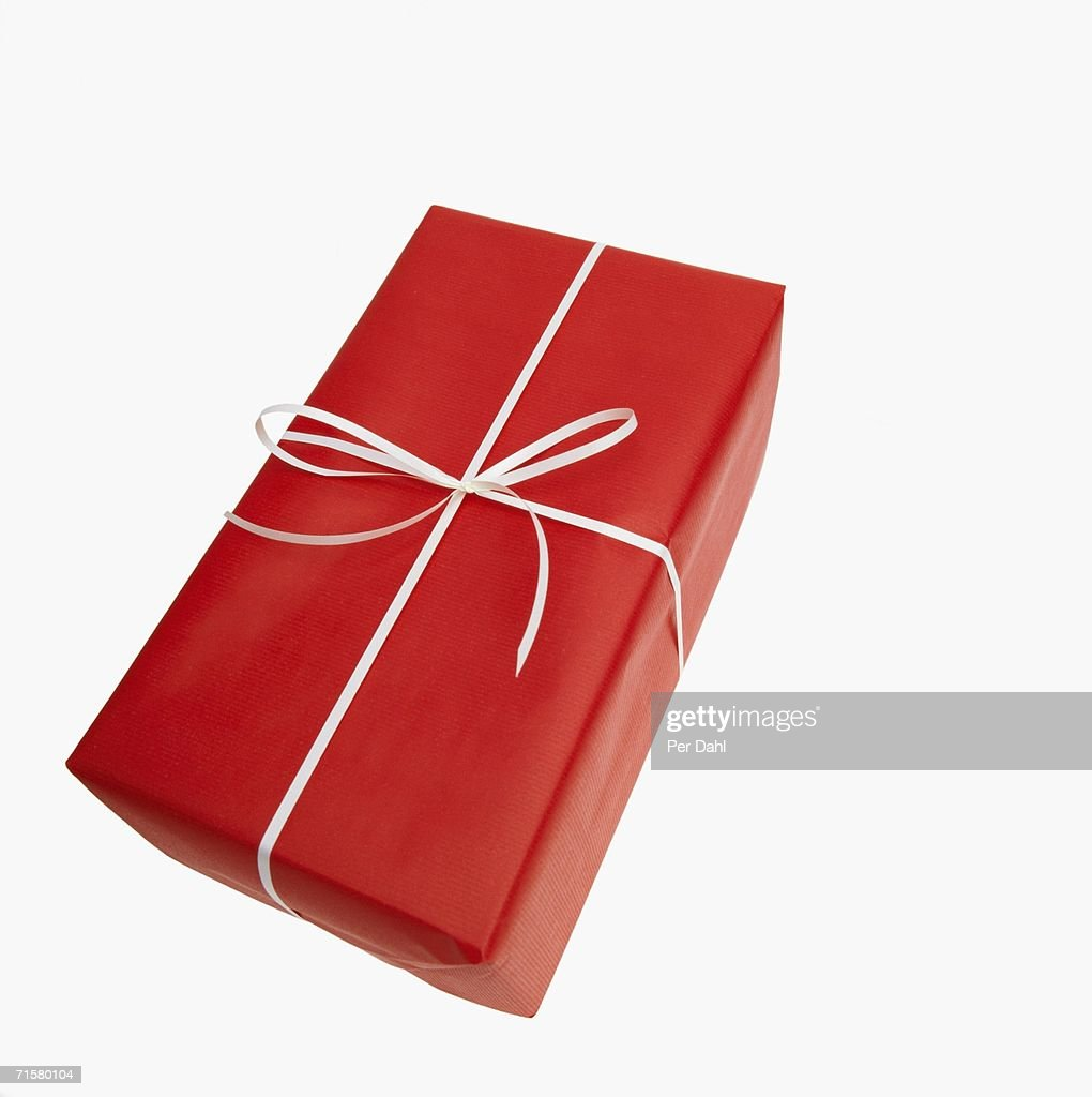 a christmas present on a white background stock photo getty images