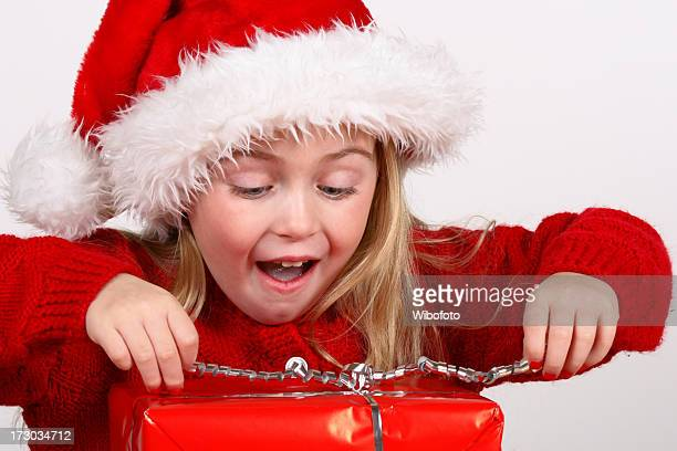 christmas present - girls open mouth stockfoto's en -beelden