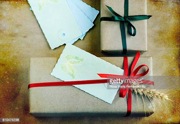 Christmas presents and greeting card with butterfly over abstract background. Top view.