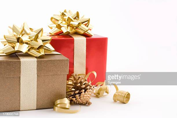 Christmas presents neatly wrapped with golden bows