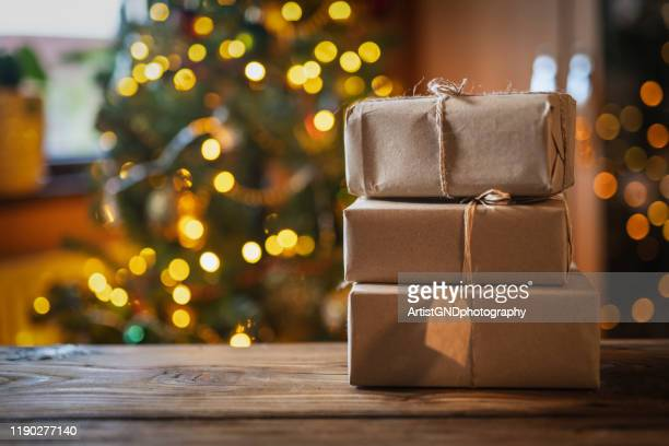 christmas presents on wooden table. - christmas present stock pictures, royalty-free photos & images