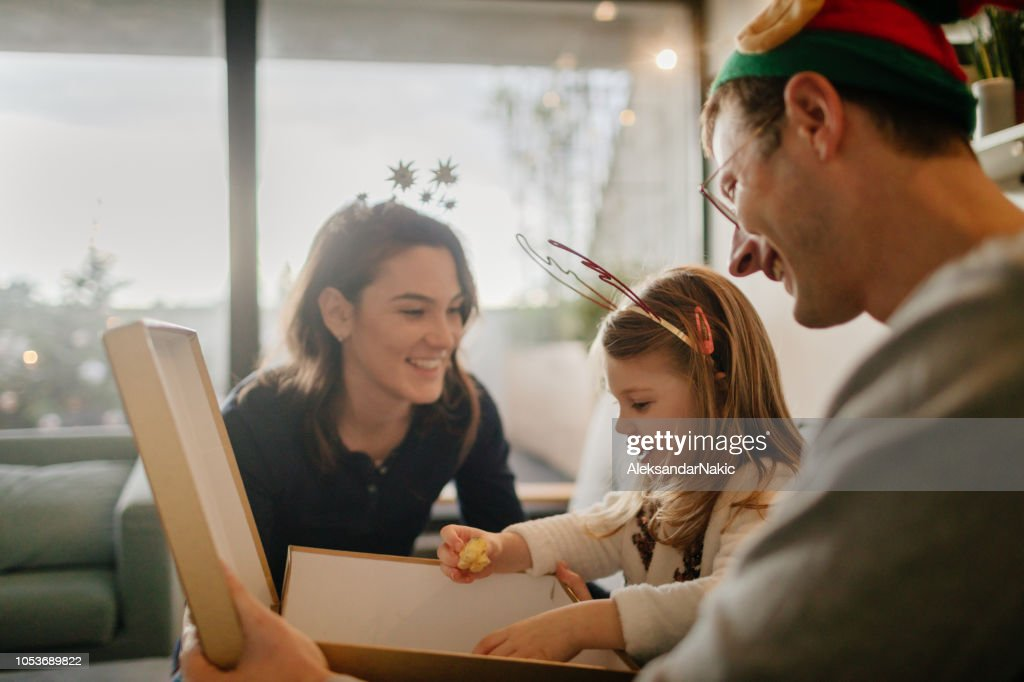 Christmas presents opening : Stock Photo