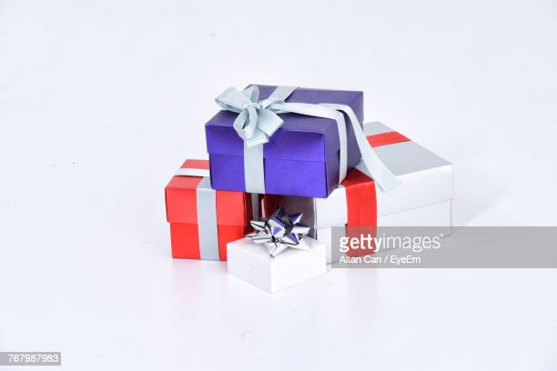 christmas presents over white background - christmas gifts stock photos and pictures