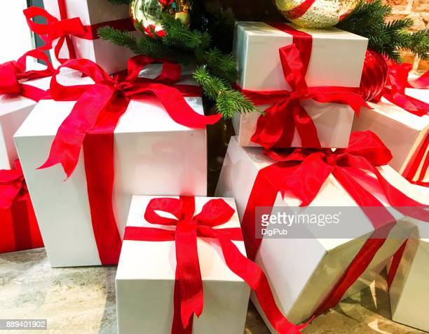 Christmas presents piled under the tree