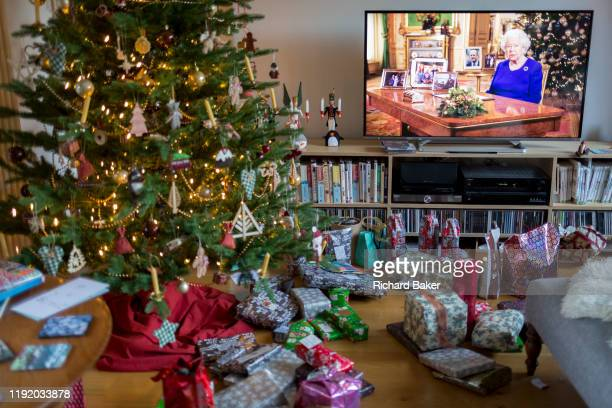 Christmas presents remain unopened beneath a Christmas tree during the Queen's speech to the nation on Christmas Day, a tradition started in 1932 and...
