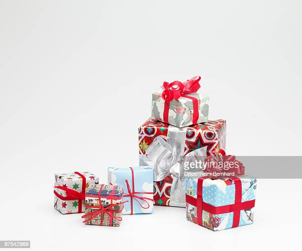 christmas presents stacked neatly in a pile