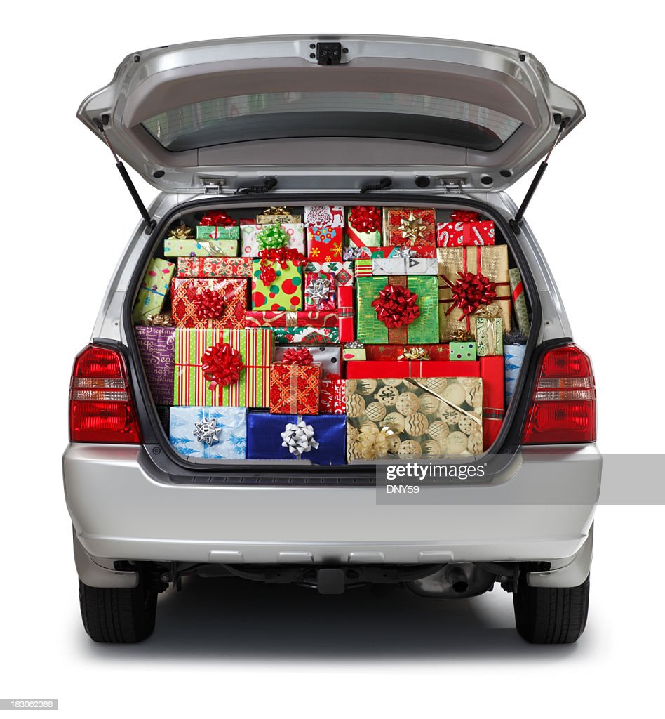 Christmas presents stuffed into SUV isolated on white background : Stock Photo