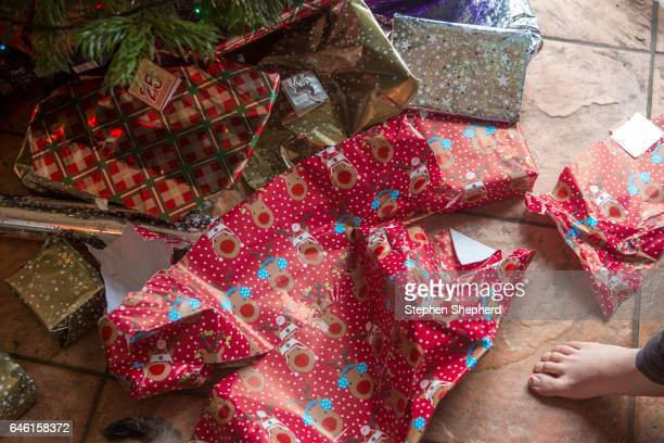 Christmas presents under a tree.