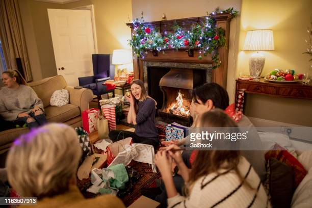 christmas presents with friends - novelty item stock pictures, royalty-free photos & images