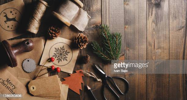 christmas presents wrapping - elevated view stock pictures, royalty-free photos & images