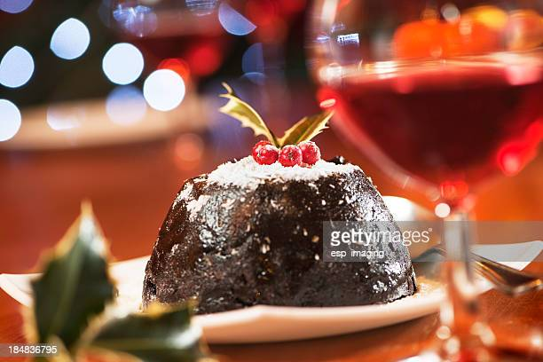 Christmas pudding and wine in warm colours scene