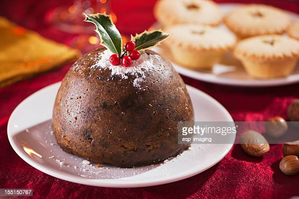 Christmas pudding on red with mince pies