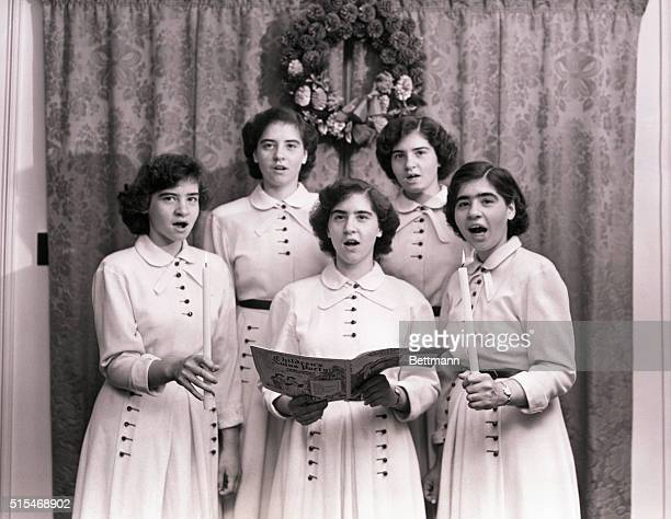 Christmas Quintet Nothing so completely exemplifies the spirit of Christmas as the singing of traditional carols That is why the Dionne Quintuplets...
