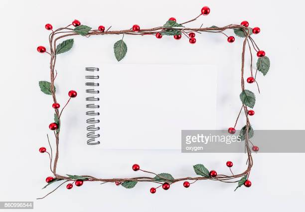 Christmas rectangular frame decoration with notepad on white background