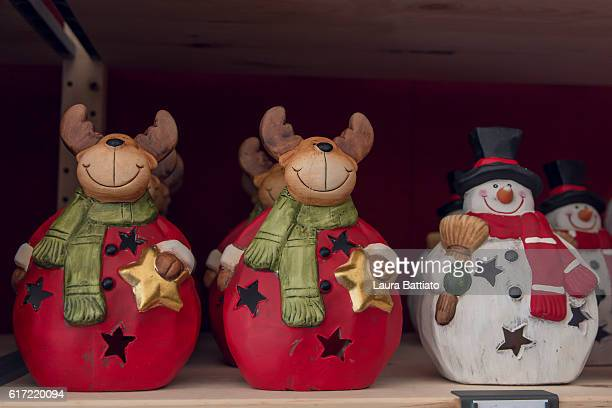 Christmas reindeers and snowman for sale in a Christmas market