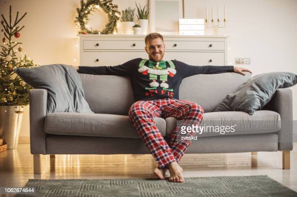 christmas relaxing - christmas jumper stock pictures, royalty-free photos & images