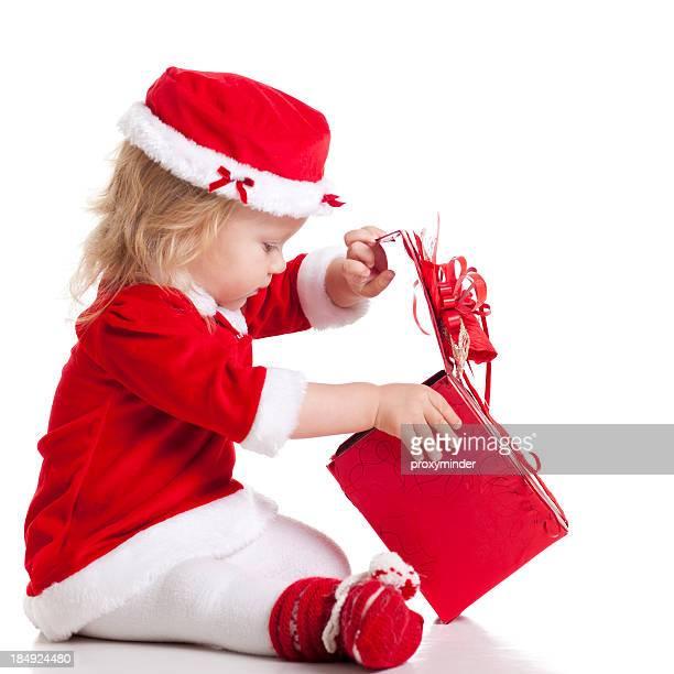 Christmas Santa Baby looking in gift box