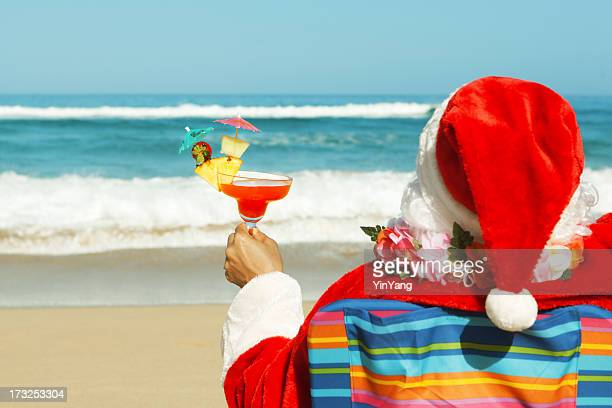christmas santa claus enjoying tropical beach vacation holiday travel - beach christmas stock pictures, royalty-free photos & images