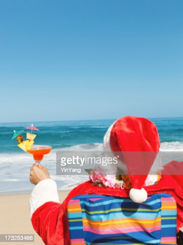 Happy Christmas Santa With Drink Enjoying Hawaiian Tropical Beach