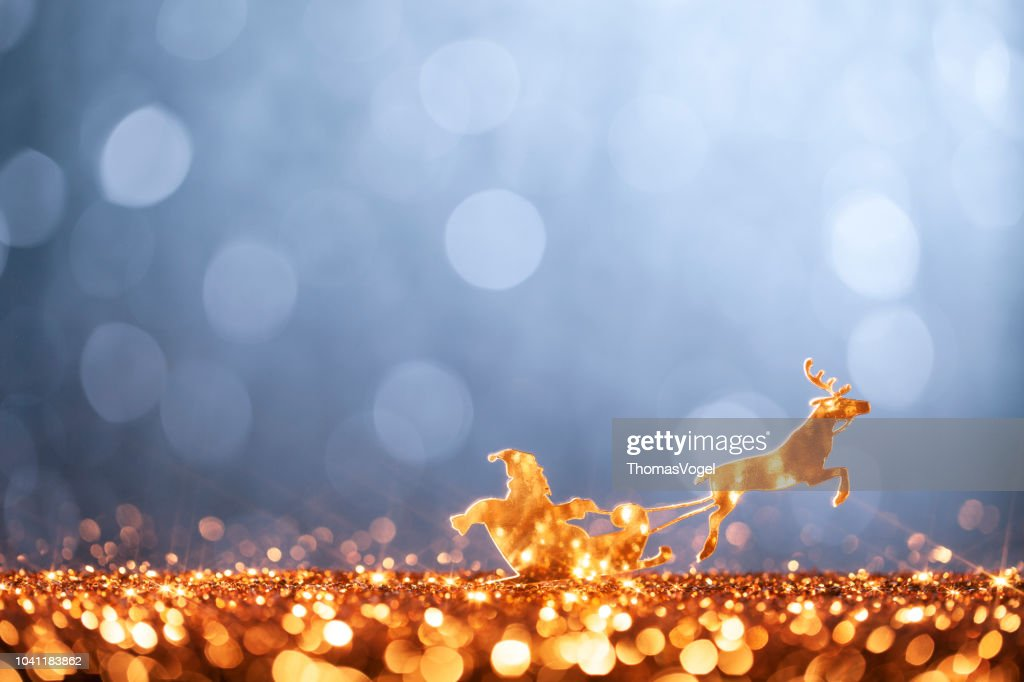 christmas santa sleigh and reindeer backgrounds defocused stock