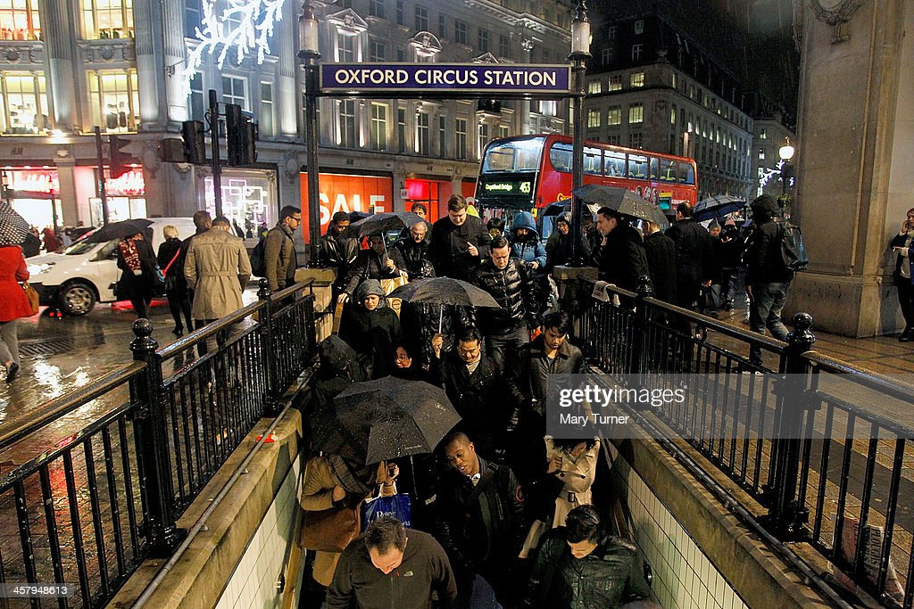 Christmas Shoppers brave rain and thunder storms to hunt for gifts at Oxford Circus on December 19, 2013 in London, England.