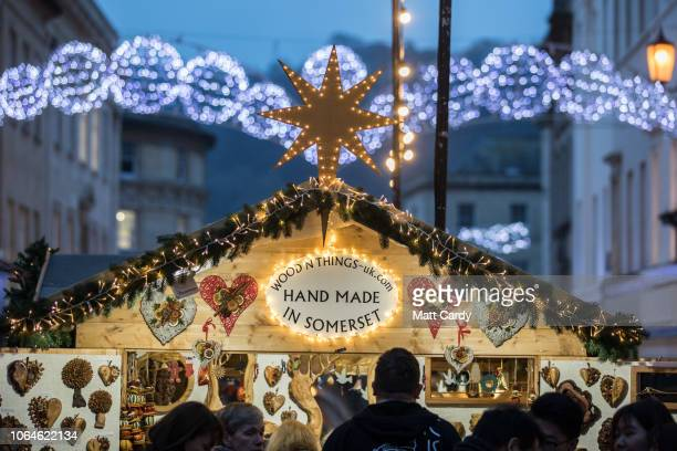 Christmas shoppers browse stalls at the traditional Christmas market that has opened in the centre of the historic city on November 23 2018 in Bath...