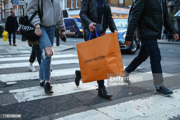 Christmas shoppers carry shopping bags on Marylebone High Street on December 23 2019 in London England There are just two days left until Christmas