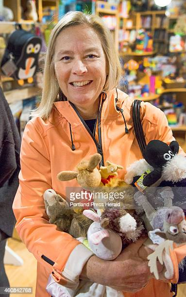 Christmas shoppers get in a last few hours of shopping on Christmas Eve in the Portland Old Port district. Ellie Baker of Cape Elizabeth picked up a...