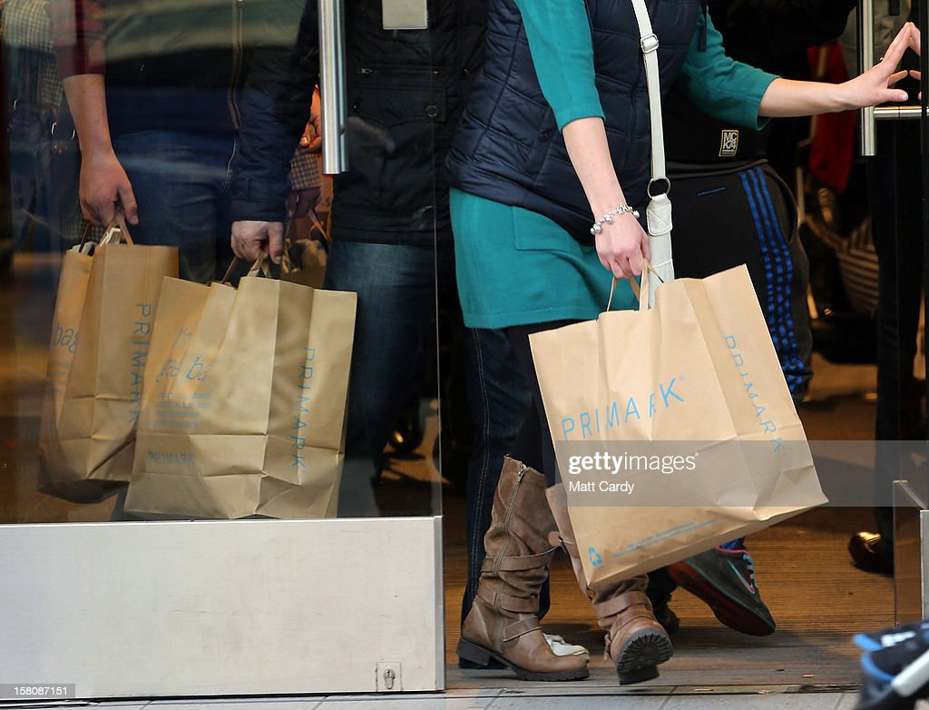 Christmas shoppers leave a high street shop on December 10, 2012 in Bristol, England. With internet shopping still on the rise, many traditional retailers claim this Christmas could be the one that will determine the future of the high street.