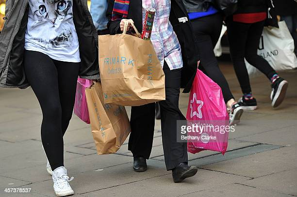 Christmas shoppers on Oxford Street carry full shopping bags on December 17 2013 in London England As Christmas Day approaches London's central...