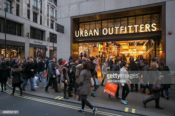 Christmas shoppers walk outside Urban Outfitters on December 14 2013 in London England As Christmas Day approaches London's central shopping...