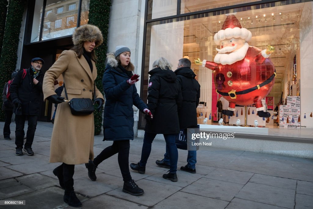 Christmas Shoppers Hit The High Street Shops In London