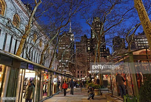 christmas shopping at bryant park in new york city - bryant park stock pictures, royalty-free photos & images