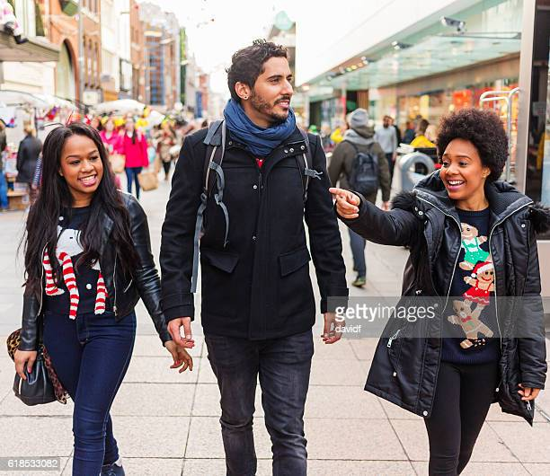 christmas shopping group of happy friends in ugly festive sweaters - ugly black women stock photos and pictures