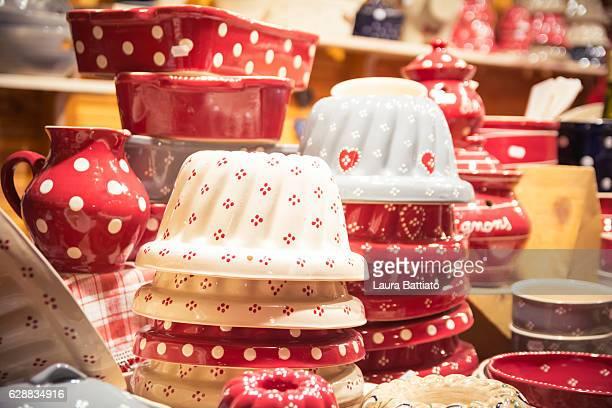 Christmas Shopping - Gugelhupf (Kugelhopf) traditional pans for sale in an Alsatian Christmas market stall