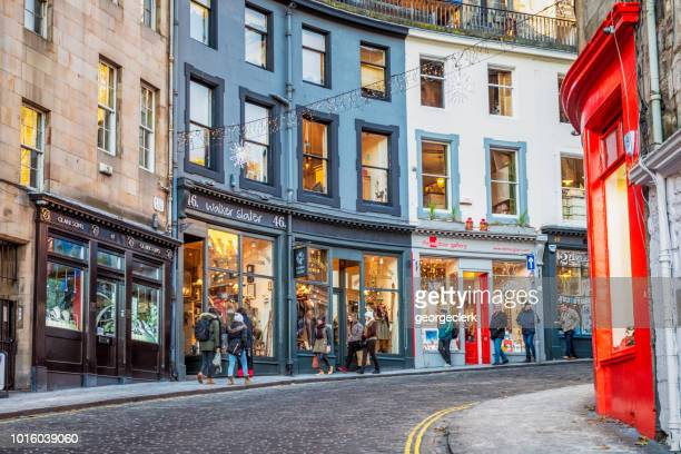 christmas shopping in edinburgh's old town - edinburgh scotland stock pictures, royalty-free photos & images