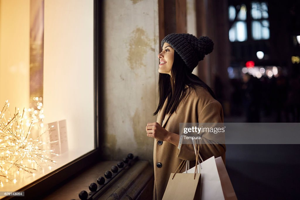 Christmas shopping looking at a window shop. : Stock Photo