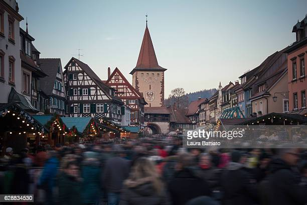 Christmas Shopping - People strolling around the Christmas market in the center of the town - Gengenbach, Germany