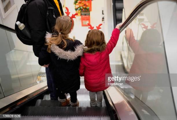 christmas shopping - embellished jacket stock pictures, royalty-free photos & images