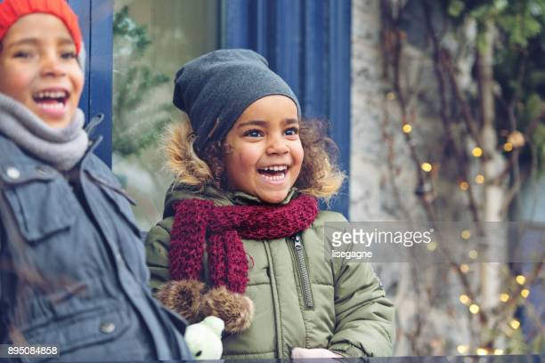 christmas shopping - winter family stock photos and pictures
