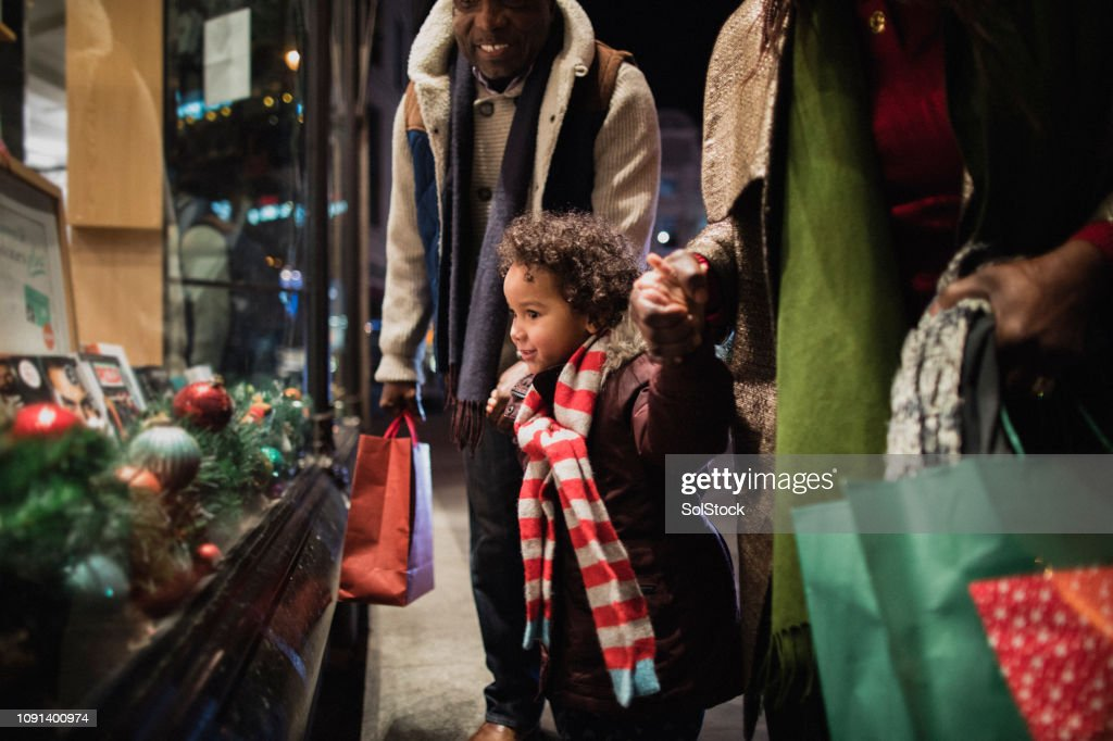 Christmas Shopping with Grandparents : Stock Photo