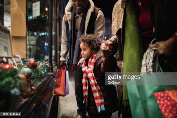 christmas shopping with grandparents - holiday stock pictures, royalty-free photos & images