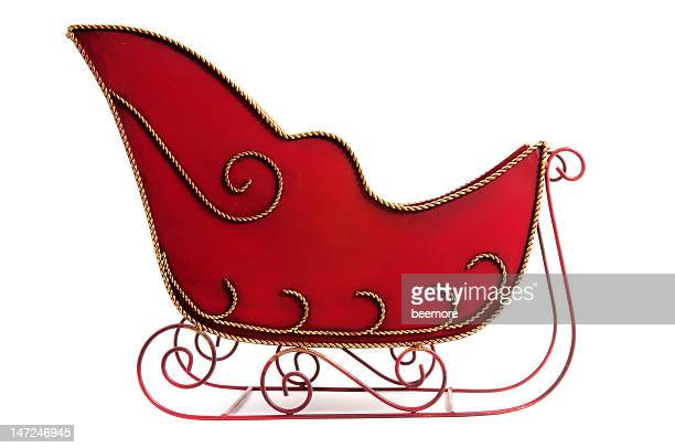 Christmas sleigh that is red and gold
