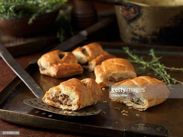 Christmas snack of gourmet sausage rolls and thyme leaves