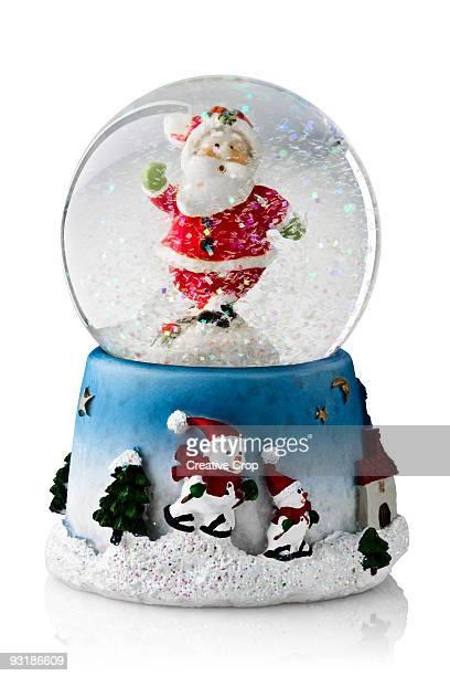 Christmas snow globe containing Father Christmas