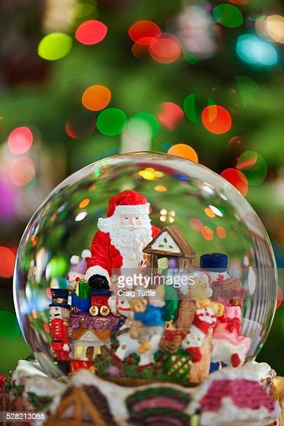 A Christmas Snow Globe With Santa Claus In It