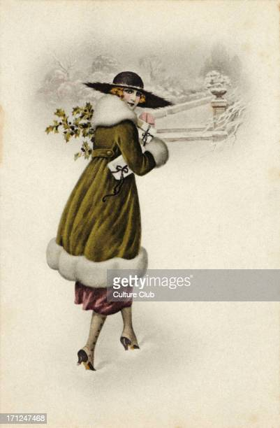 Christmas snow scene Fashionable young woman carrying present wrapped with ribbons Broad brimmed hat