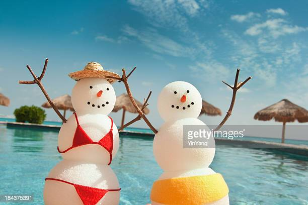 Christmas Snowman Enjoying Winter Beach Vacation Fun by Swimming Pool