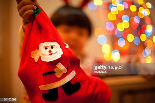 Christmas sock holding by  little boy