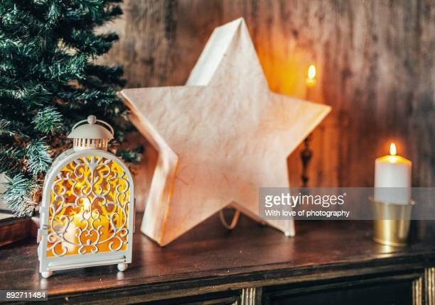 christmas star and candle light decor,  decorating home for winter holidays, christmas decorations background